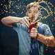 Man drinking a cola and enjoying the spray. - PhotoDune Item for Sale