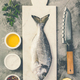 Delicious fresh sea bream fish, flat lay, top view - PhotoDune Item for Sale