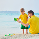 Toddler boy on beach with father - PhotoDune Item for Sale