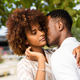 Outdoor protrait of black african american couple kissing each o - PhotoDune Item for Sale