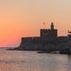 sunrise in Mandraki harbour. Rhodes, Greece - PhotoDune Item for Sale
