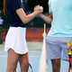 Group of tennis player handshaking after playing a tennis match. Fairplay, sport concept - PhotoDune Item for Sale