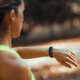 Woman Looking at Smart Watch after Outdoor Training - PhotoDune Item for Sale