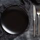 Black plate on a dark background - PhotoDune Item for Sale
