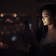 Woman use of mobile phone indoors at night - PhotoDune Item for Sale