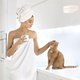 Young woman in towel enjoying coffee at home - PhotoDune Item for Sale