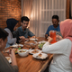 asian muslim family dinner together. break fasting - PhotoDune Item for Sale