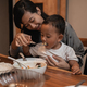 mother with her son eating together while dinner - PhotoDune Item for Sale