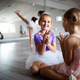 Group of little ballerinas girls doing exercises in dance school - PhotoDune Item for Sale