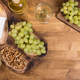 Top view of wolnuts next to fresh grapes on wooden plate in a vintage restaurant - PhotoDune Item for Sale