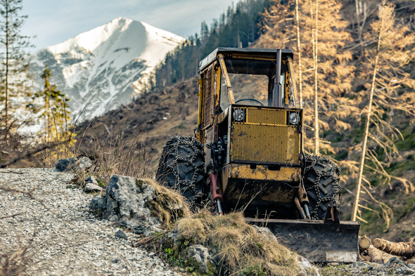 Bulldozer resting in high mountains after work - Stock Photo - Images