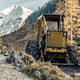 Bulldozer resting in high mountains after work - PhotoDune Item for Sale