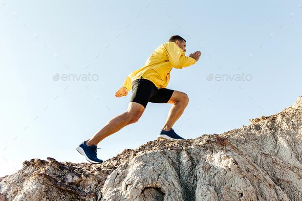 man climb uphill mountain - Stock Photo - Images