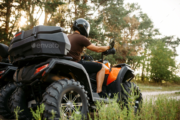 Rider in helmet on quad bike, front view, closeup - Stock Photo - Images