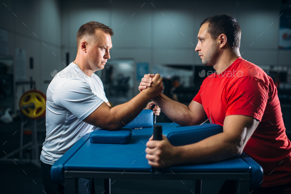 Two arm wrestlers on starting position, wrestling - Stock Photo - Images