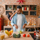 Black couple having fun while cooking on kitchen - PhotoDune Item for Sale