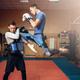 Male kickboxer doing kick in jump, kickboxing - PhotoDune Item for Sale