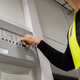 Male Electrician Opening Fire Panel In Server Room - PhotoDune Item for Sale