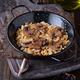 serving of rice with mushrooms in metal frying pan on wood - PhotoDune Item for Sale