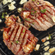 grilled steaks on grilling pan - PhotoDune Item for Sale