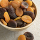 Bowl with orange and brown dried apricots - PhotoDune Item for Sale