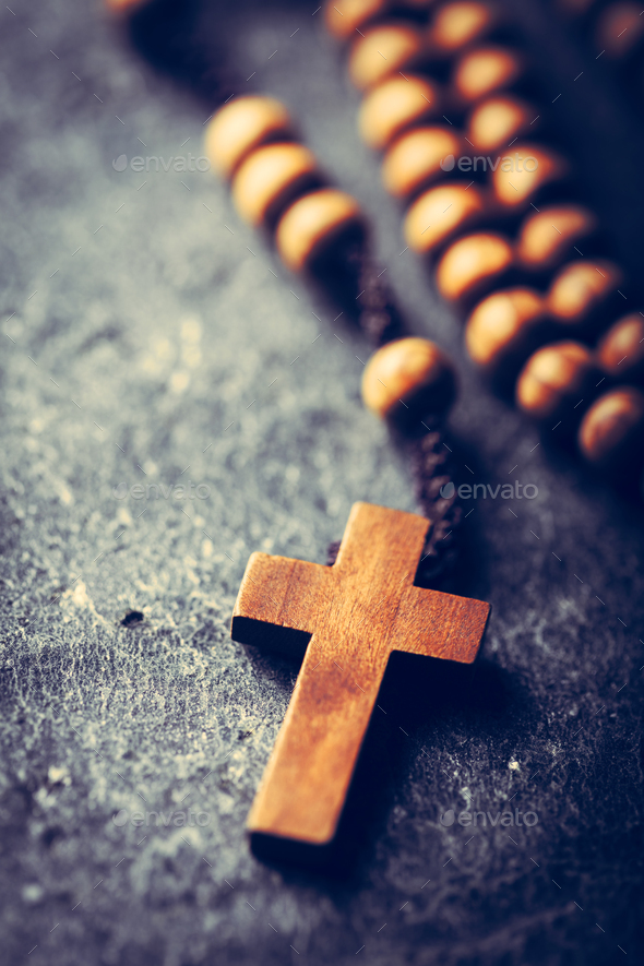 Cross and rosary on stone background. - Stock Photo - Images