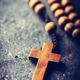 Cross and rosary on stone background. - PhotoDune Item for Sale