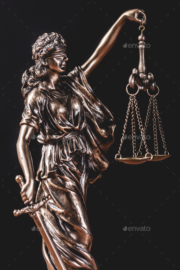 Themis statue holding a scale - Stock Photo - Images