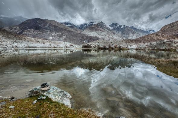 Mountain lake Lohan Tso in Himalayas - Stock Photo - Images