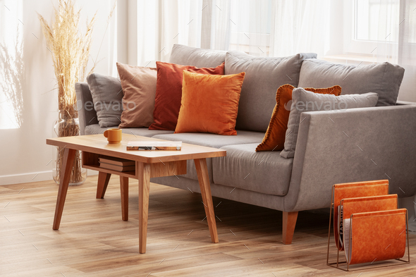 Outstanding Living Room With Wooden Coffee Table And Grey Couch With Ginger Orange And Red Pillows Andrewgaddart Wooden Chair Designs For Living Room Andrewgaddartcom
