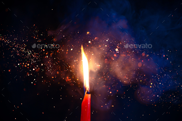 Smoke and fire texture with sparkles  Candle flame on a black background  with gradient blue and
