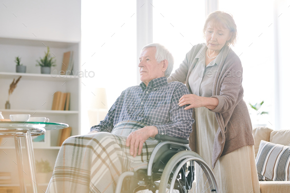 Caring of disable man - Stock Photo - Images