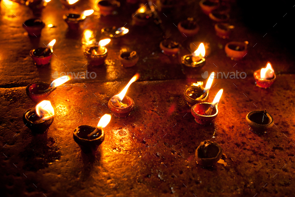 Burning oil lamps at Hindu temple. India - Stock Photo - Images