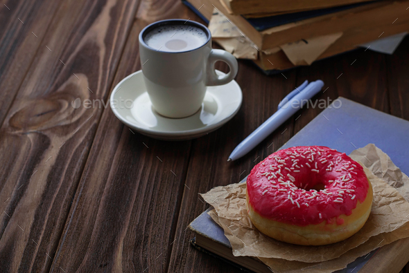 Donut and cup of coffee - Stock Photo - Images