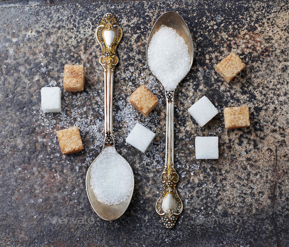 White and brown sugar in spoon. - Stock Photo - Images