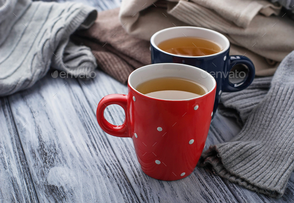 Warm knitted pastel clothes and cups - Stock Photo - Images