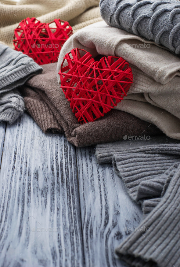Warm knitted pastel clothes and hearts - Stock Photo - Images