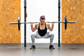 Young girl doing a back squat with a barbell - PhotoDune Item for Sale