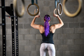 Woman athlete preparing to work out on the rings - PhotoDune Item for Sale