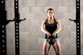 Young woman working out with a kettlebell - PhotoDune Item for Sale
