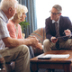 Male physician interacting with senior Caucasian couple at retirement home - PhotoDune Item for Sale
