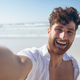 Man taking a selfie standing and at beach - PhotoDune Item for Sale