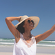 Woman talking selfie at beach on sunny day - PhotoDune Item for Sale