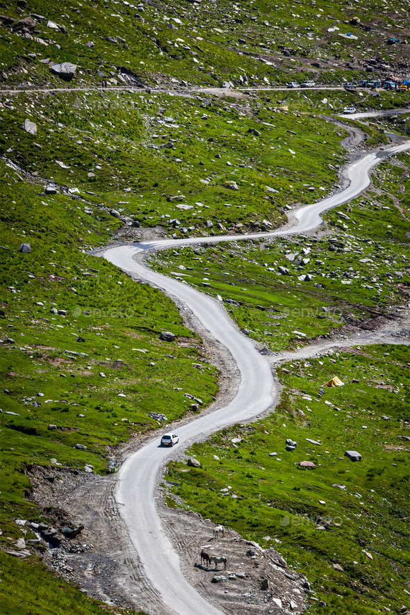 Serpentine road in Himalayas mountains - Stock Photo - Images