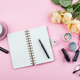 Workplace mockup with notebook, glasses, roses and accessories on pink background top view. Flat lay - PhotoDune Item for Sale