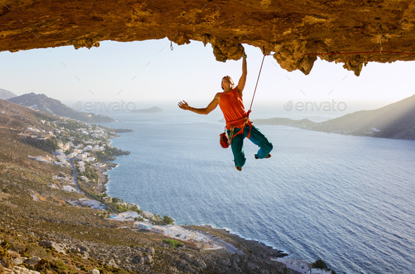 Male rock climber on challenging route  - Stock Photo - Images