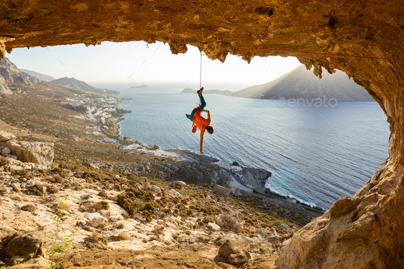 Rock climber hanging on rope after falling of cliff - Stock Photo - Images