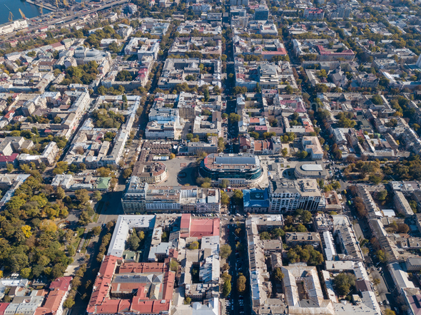 Aerial view from the drone on the shopping center, buildings and streets with cars on a sunny day - Stock Photo - Images