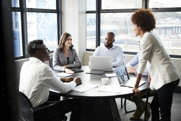 Millennial black businesswoman stands addressing corporate colleagues at a meeting, close up - Stock Photo - Images