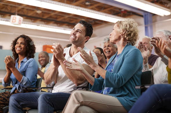 Group Attending Neighborhood Meeting In Community Center Clapping - Stock Photo - Images